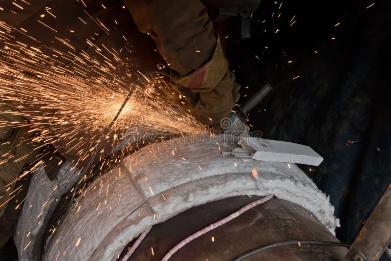 Protecive-Wurzel der Schweißung die Schneidemaschine stockfotografie