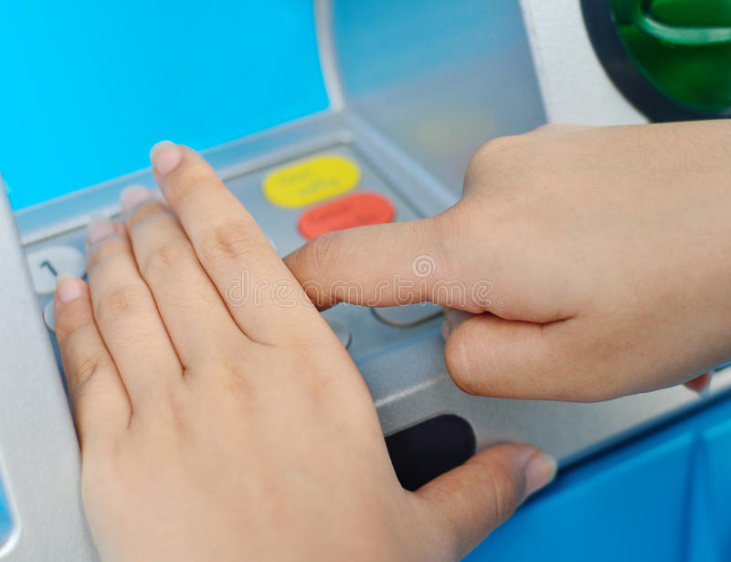 Protect of ATM pin by hands. Human hand enter atm banking cash machine pin code royalty free stock image