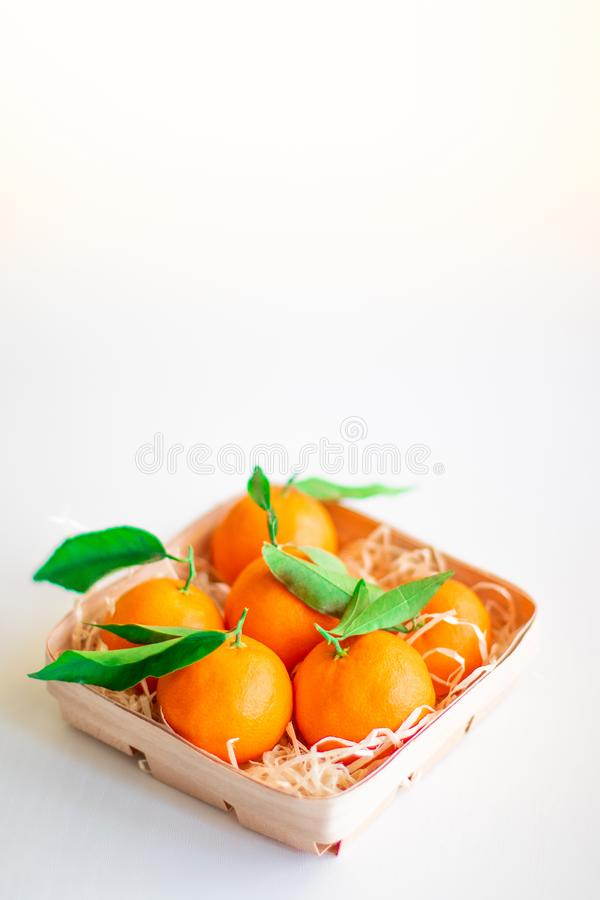 Protect the body from germs. Health security. Fresh picked mandarins on isolated on white background / Protect the body from germs. Health security royalty free stock photography