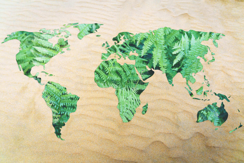 Protect the environment from desertification: world map with lea. Desertification and environmental awareness: world with sand instead of oceans royalty free stock photo