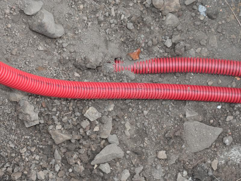 Protect HDPE tube. Laying underground tow cable stock photography