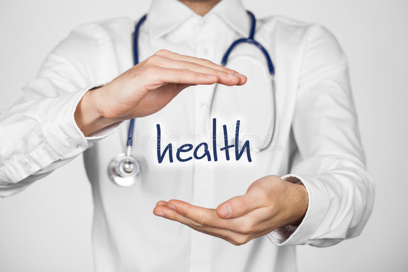 Protect health. Concept. Doctor with protective gesture and text health stock image