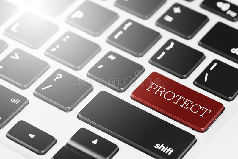 'PROTECT ' Red button keyboard on laptop computer for Business an stock photos