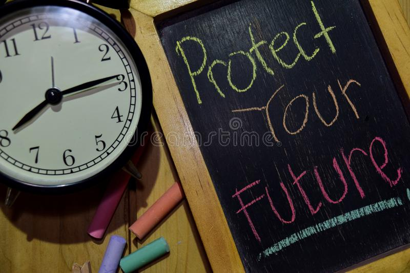 Protect Your Future on phrase colorful handwritten on chalkboard stock photo