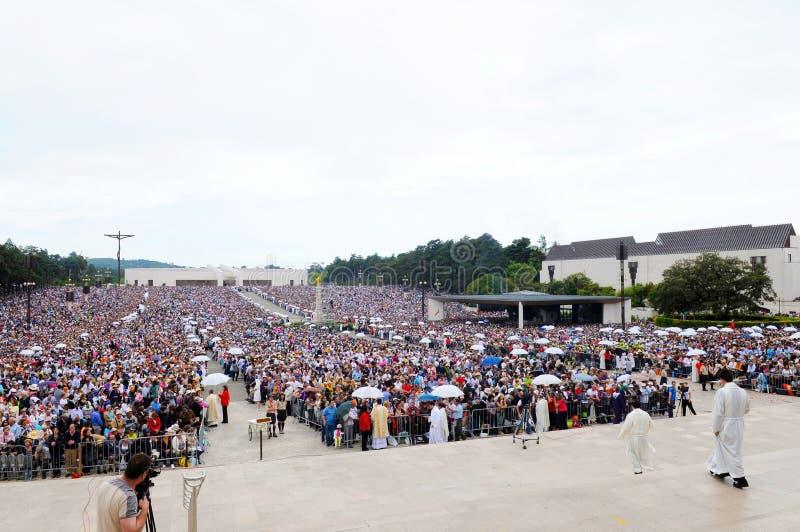 Catholic Pilgrims taking Sacred Host, Religion, Faith royalty free stock image