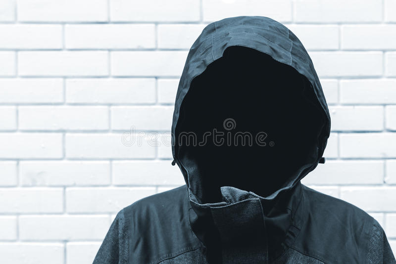 Protected witness identity concept. With faceless hooded person royalty free stock images