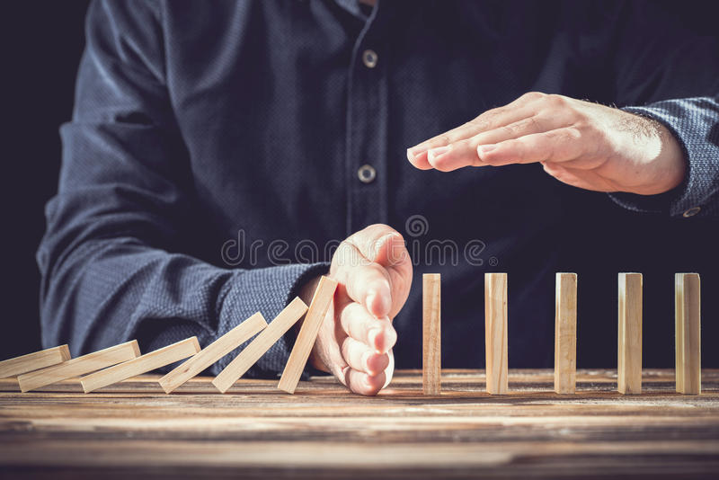 Protecting Assets From Domino Effect. Stop Loss Concept. Protecting Assets From Domino Effect. Stop Loss Concept For Stock Exchange Market royalty free stock photos