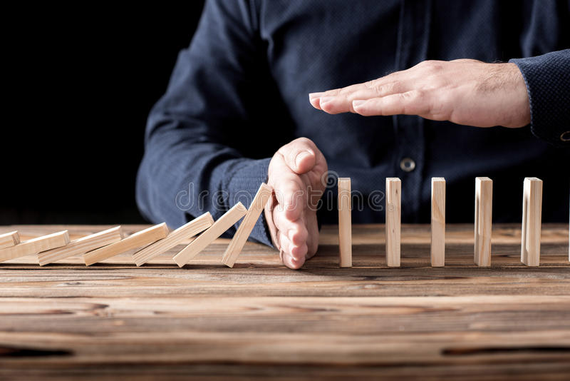 Protecting Assets From Domino Effect. Stop Loss Concept. royalty free stock image