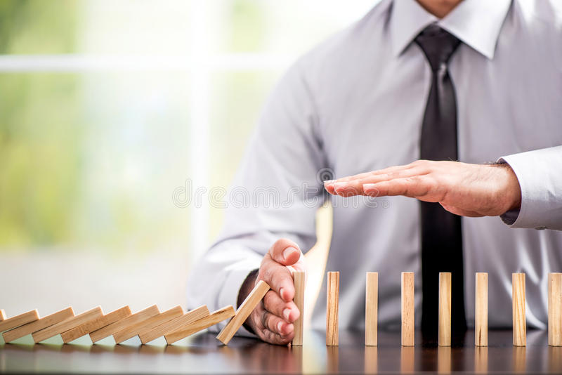 Protecting Assets From Domino Effect. Stop Loss Concept. stock images