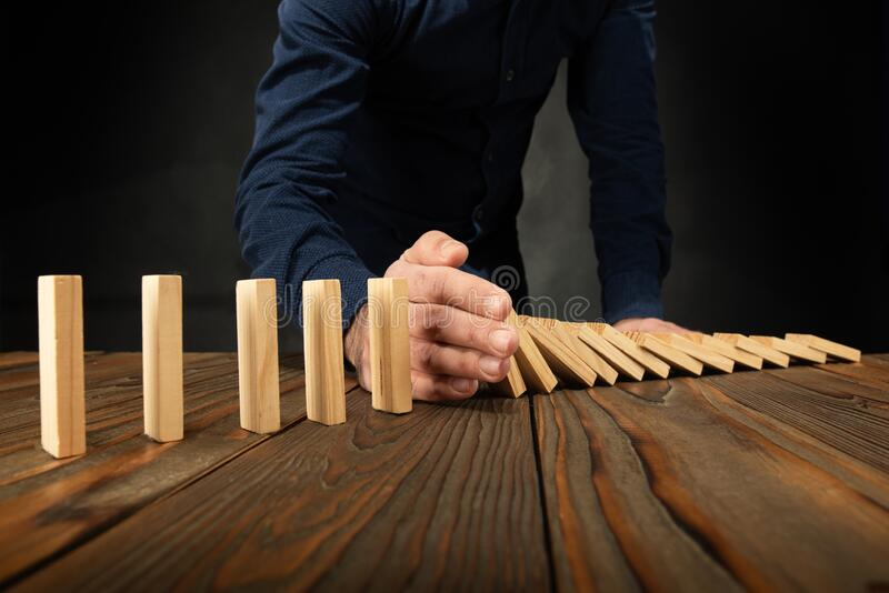Protecting Assets From Domino Effect. stock photo