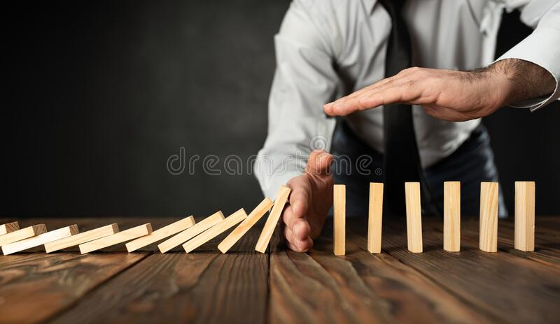 Protecting Assets From Domino Effect. Stop Loss Concept royalty free stock photo