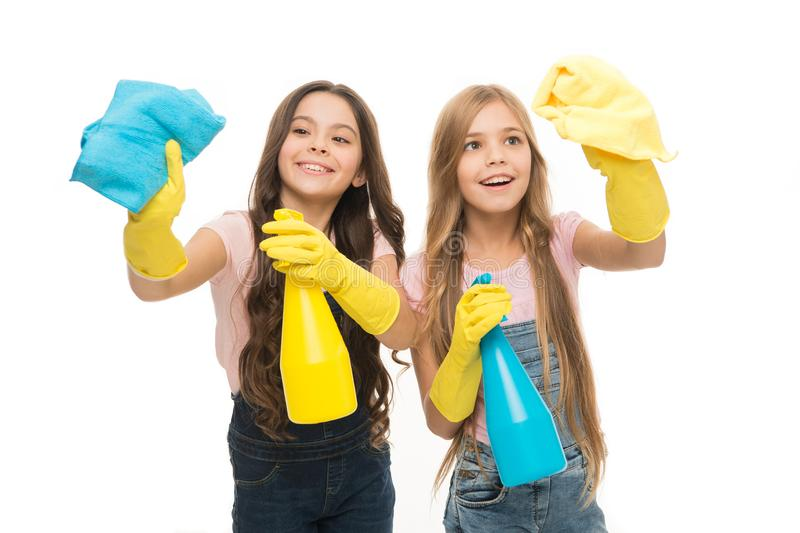 Protecting their home from dirt. Small housegirls dusting and cleaning home. Little home keepers holding spray bottles stock photography