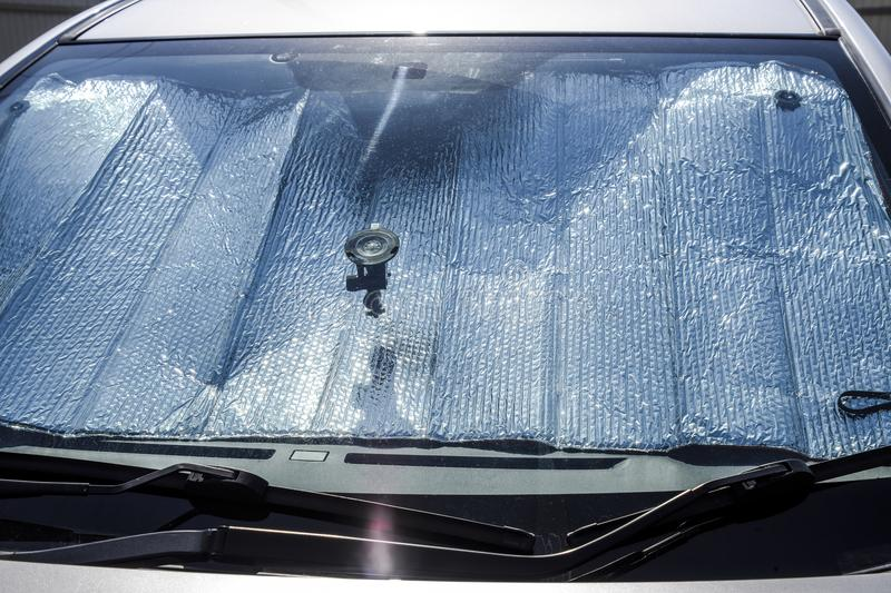 Protection of the car panel from direct sunlight. Sun Reflector. Windscreen royalty free stock photography