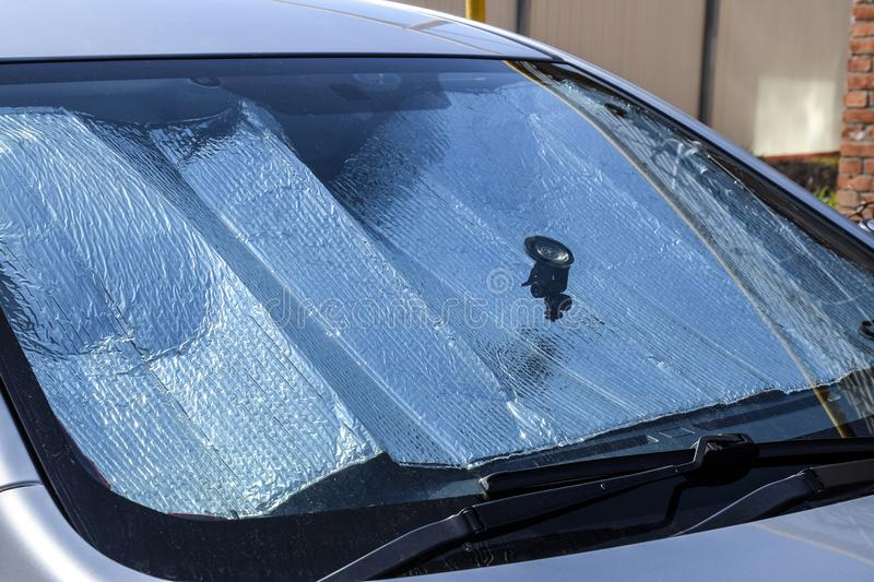Protection of the car panel from direct sunlight. Sun Reflector. Windscreen stock photo