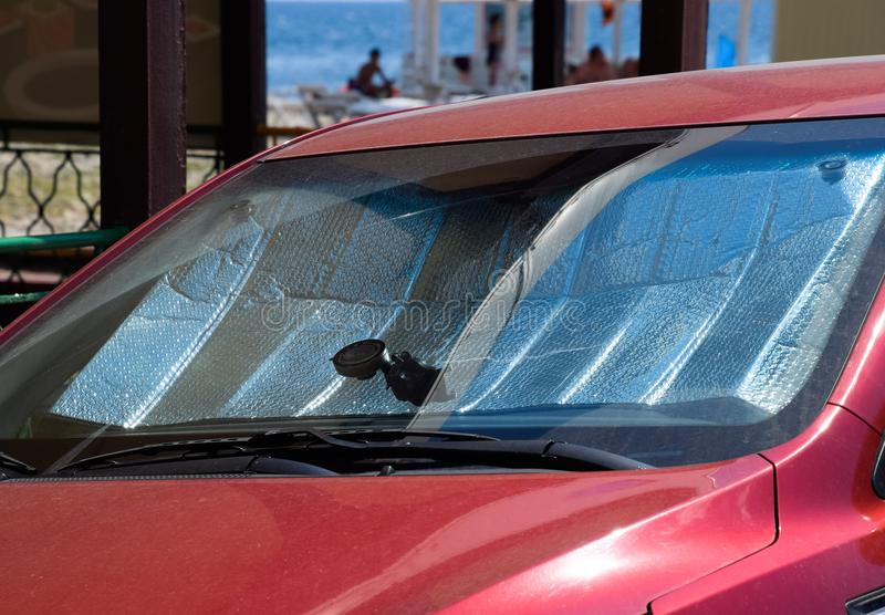Protection of the car panel from direct sunlight. Sun Reflector windscreen stock photography