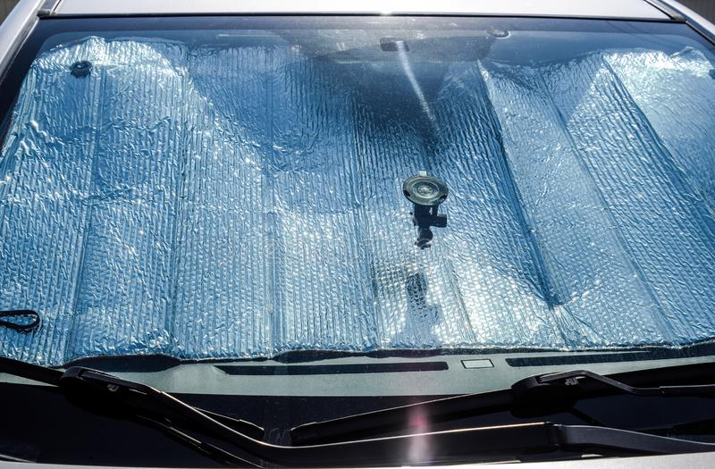Protection of the car panel from direct sunlight. Sun Reflector. Windscreen stock photos