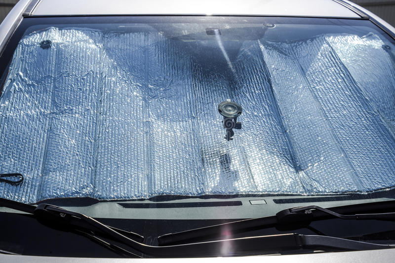 Protection of the car panel from direct sunlight. Sun Reflector windscreen.  royalty free stock images