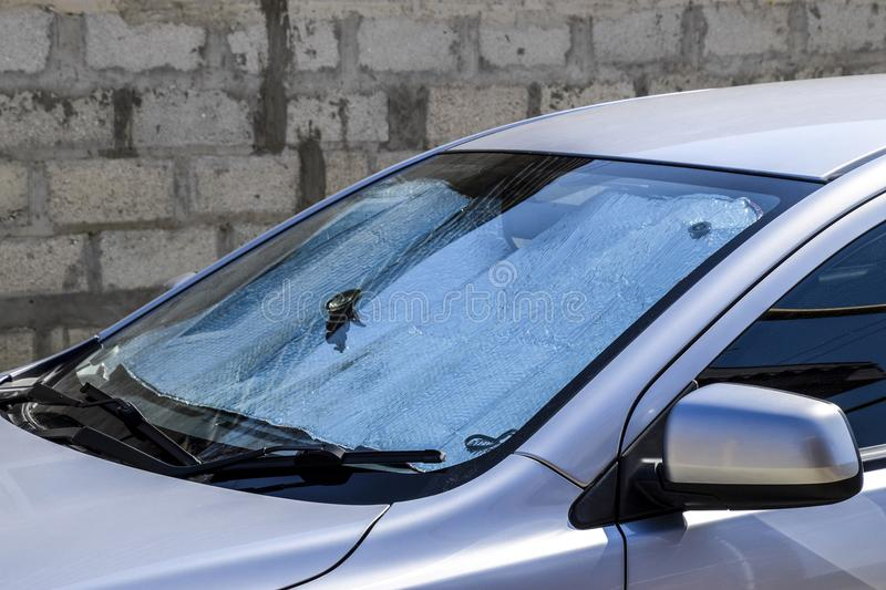 Protection of the car panel from direct sunlight. Sun Reflector. Windscreen stock photography