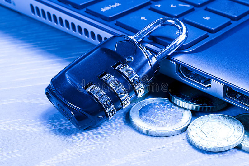 Protection for computer - Number lock. Padlock and money coins near computer keyboard. Financial Security Concept, secure computer transaction. Cyber risk royalty free stock photo