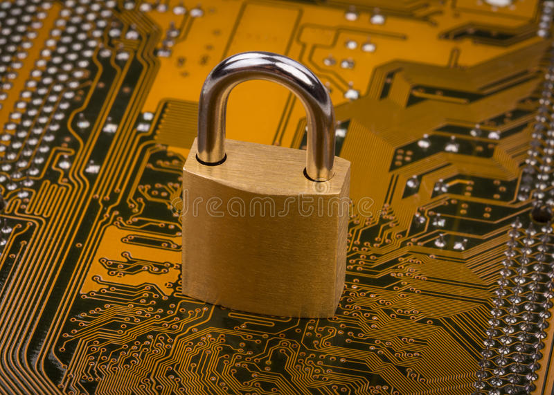 Protection concept : security lock. On computer circuit board royalty free stock photos