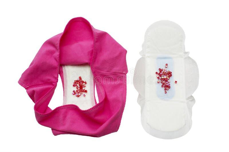 Protection sanitaire de règles avec les perles, pantalon rose pour la protection d'hygiène de femme Protection tendre douce penda photos libres de droits
