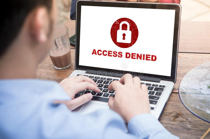 Your access is denied on laptop screen concept, protection security system. Protection security system concept. Man working on laptop with access denied text on royalty free stock images