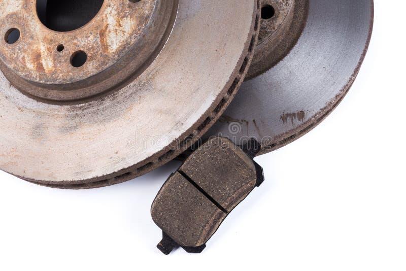 Protections de frein et disques de frein sur le fond blanc photos stock
