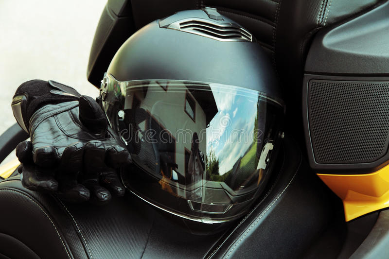 Protective clothing and safety in motorsport. Motorcycle helmet and gloves stock photography