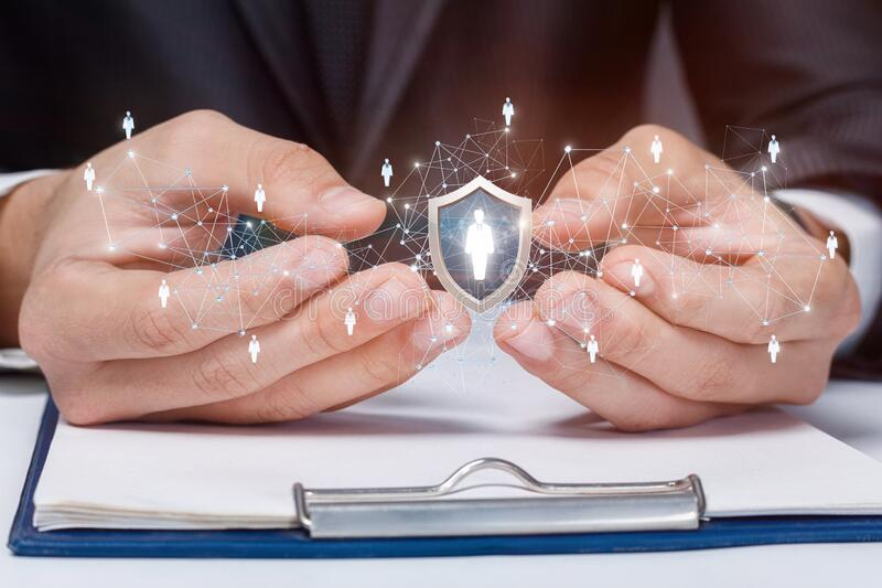 Protective customer insurance. Hands of businessmen show a shield with an icon of a client stock photo