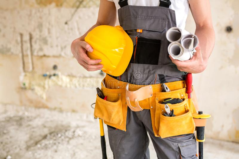 Protective gear, working tools, projects and a helmet stock photos