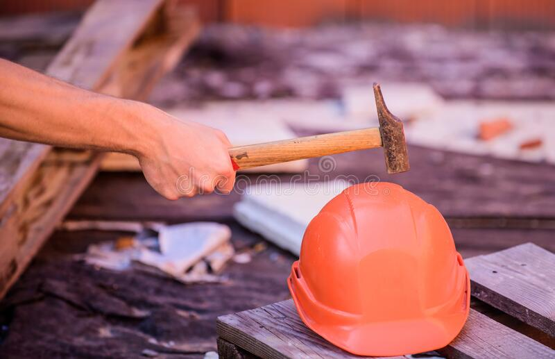 Protective helmet. Material strength. Building construction. Professional hard hat. Engineer architect repairer safety royalty free stock photography