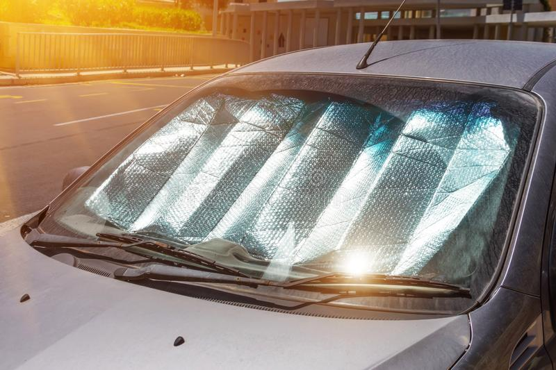 Protective reflective surface under the windshield of the passenger car parked on a hot day, heated by the sun`s rays inside the. Car royalty free stock photos