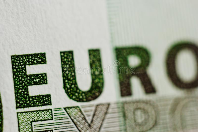 Protective watermark on a hundred euro bill in macro. protection against counterfeiting of banknotes. hologram. detail of paper. Money close up stock images