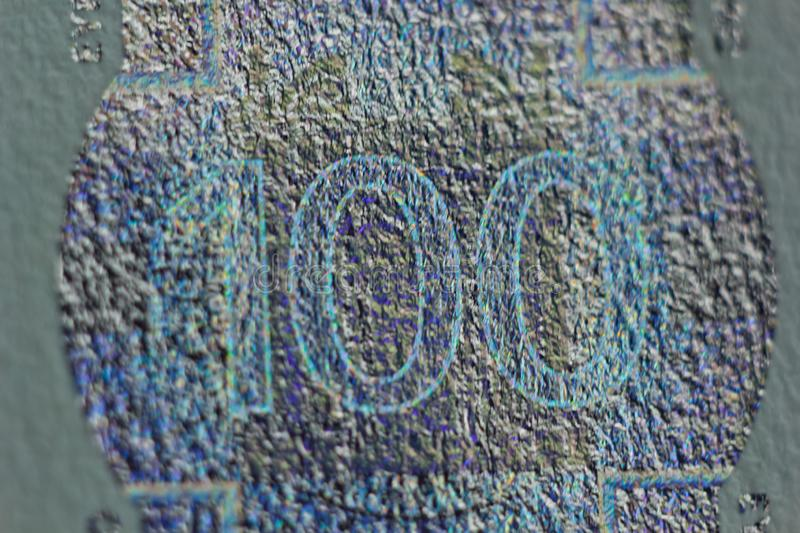 Protective watermark on a hundred euro bill in macro. protection against counterfeiting of banknotes. hologram. detail of paper. Money close up stock photography