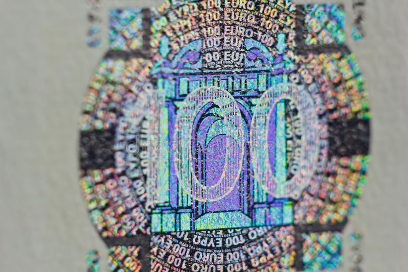 Protective watermark on a hundred euro bill in macro. protection against counterfeiting of banknotes. hologram. detail of paper. Money close up stock photos