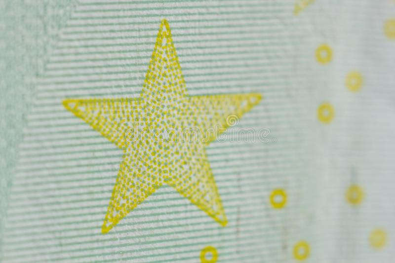 Protective watermark on a hundred euro bill in macro. protection against counterfeiting of banknotes. hologram. detail of paper. Money close up royalty free stock photography