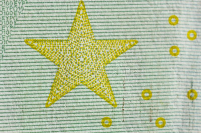 Protective watermark on a hundred euro bill in macro. protection against counterfeiting of banknotes. hologram. detail of paper. Money close up stock image