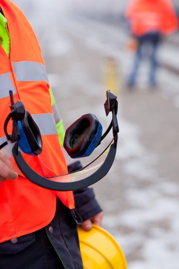 Protector auricular e capacete fotografia de stock royalty free