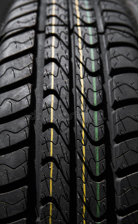 Protector of automobile tires. Close up view on auto mobile new wheel tire surface. Car constraction industry commercial royalty free stock photos