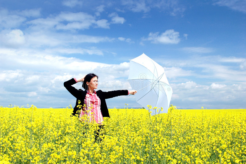 Protects your business 3. Young woman on yellow field with white umbrela. Conceptual business for customer support, insurance, social protection, delivering