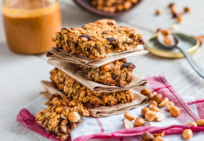 Protein bars granola with seeds, peanut butter and dried fruit,. Healthy snack on wooden background royalty free stock photography