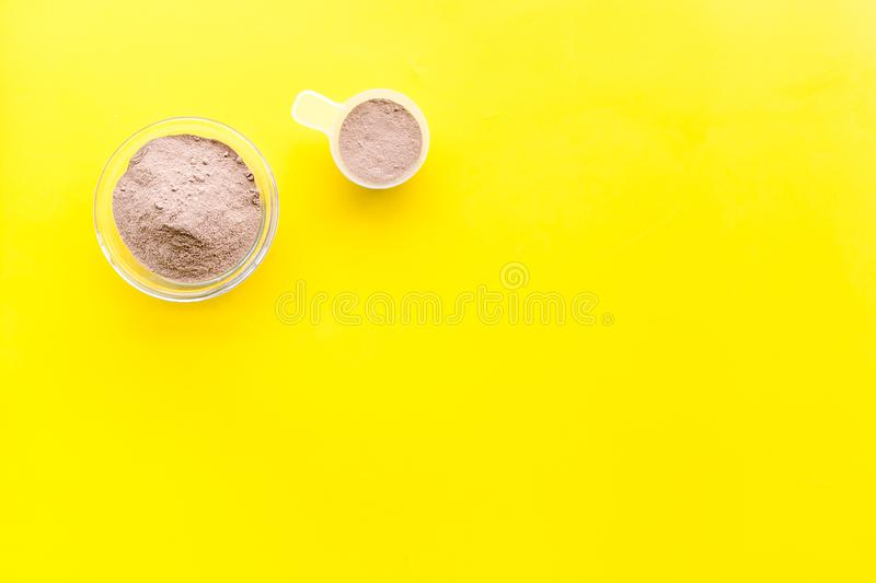 Protein cocktail with powder for sport nutrition set l on yellow background top view mock-up royalty free stock photo