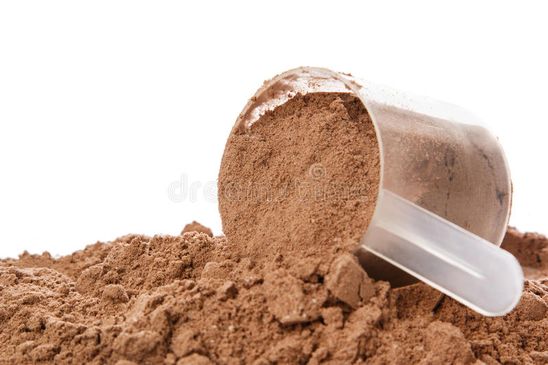 Protein powder. Close up of protein powder and scoop stock photos