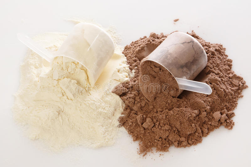 Protein powder. Close up of protein powder and scoops royalty free stock photos
