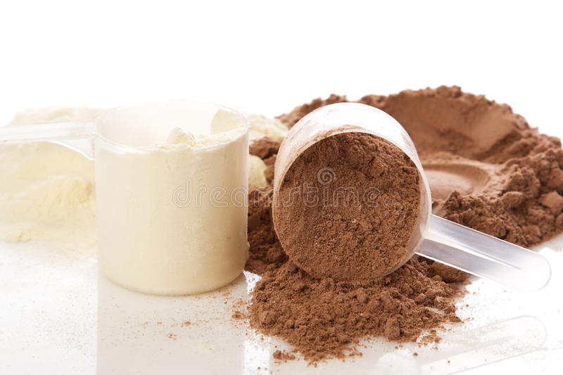 Protein powder. Close up of protein powder and scoops royalty free stock image