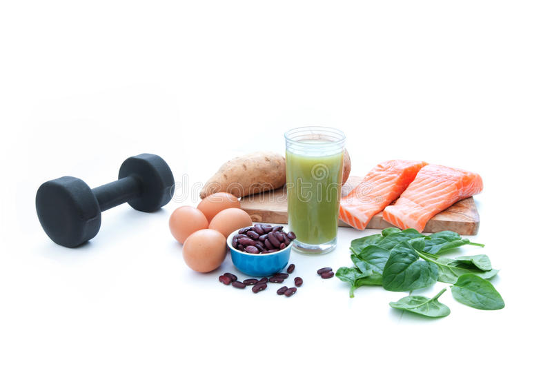Protein foods and dumbell stock photography