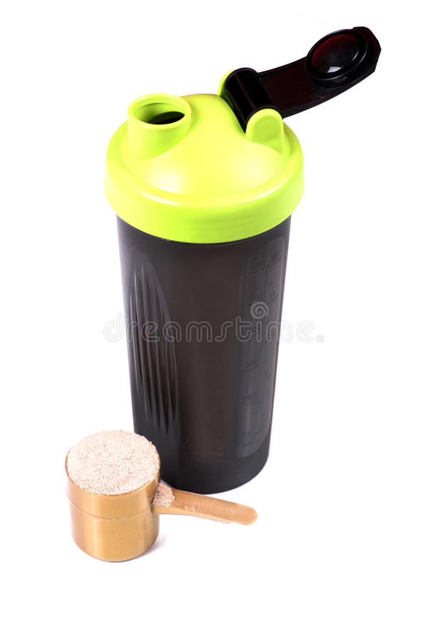 Protein shaker. Beautiful shot of protein shaker with whey protein scoop on white background stock photography