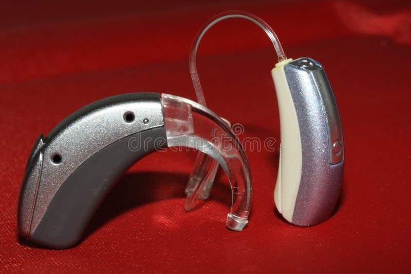 Protesi acustiche e dispositivi assistive fotografie stock libere da diritti