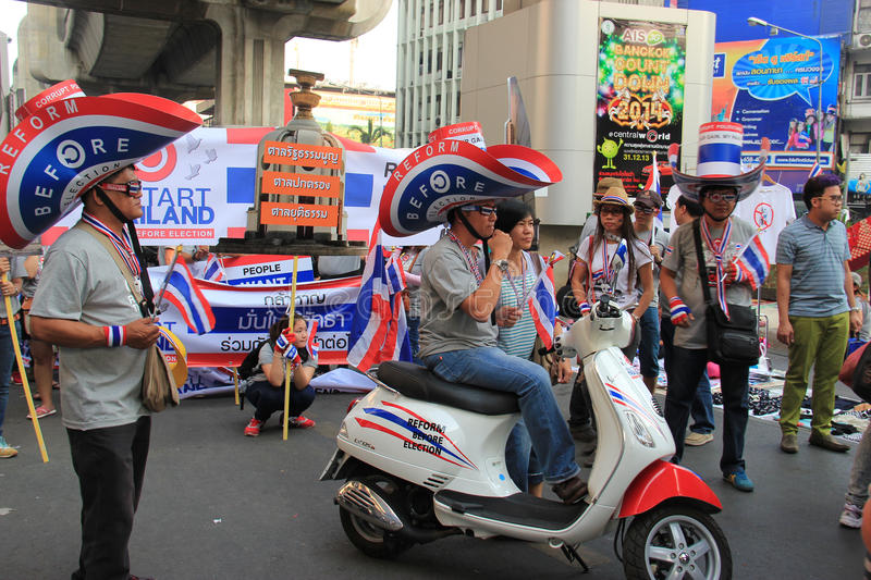 Protest against Amnesty Bill. Bangkok, Thailand - January 26, 2014: Protestors hold an anti-government rally use different many products with Thailand Flag stock photos