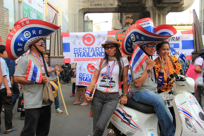 Protest against Amnesty Bill. Bangkok, Thailand - January 26, 2014: Protestors hold an anti-government rally use different many products with Thailand Flag royalty free stock photos